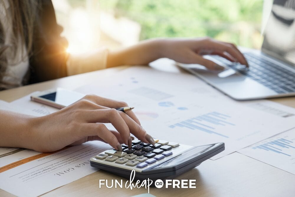 Woman working on her financial goals with a laptop and a calculator, from Fun Cheap or Free