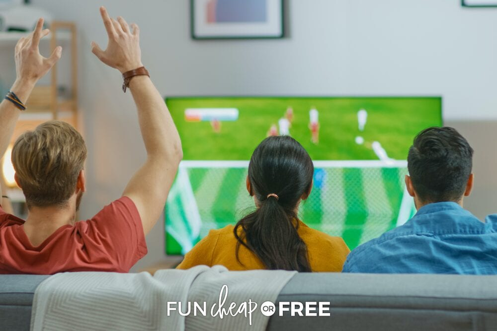 Friends sitting on couch watching soccer game, from Fun Cheap or Free