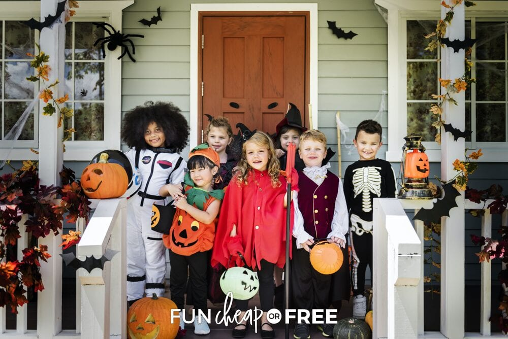 Kids in costume on a porch with Halloween party ideas around them, from Fun Cheap or Free