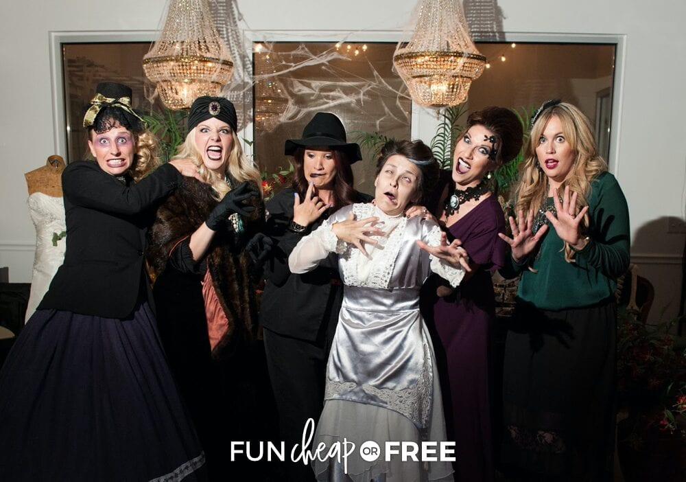 Women in various spooky costumes taking a picture, from Fun Cheap or Free