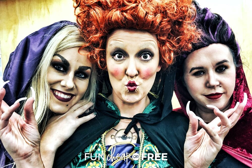Three women dressed up like the Sanderson Sisters at a Halloween party, from Fun Cheap or Free