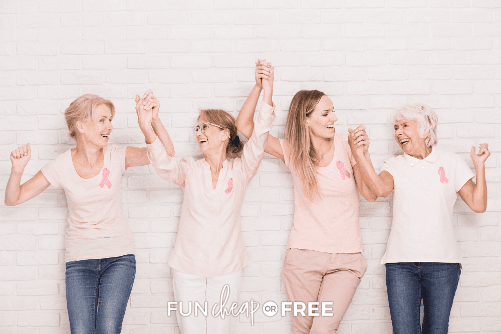 four women linking arms to celebrate breast cancer awareness free mammograms