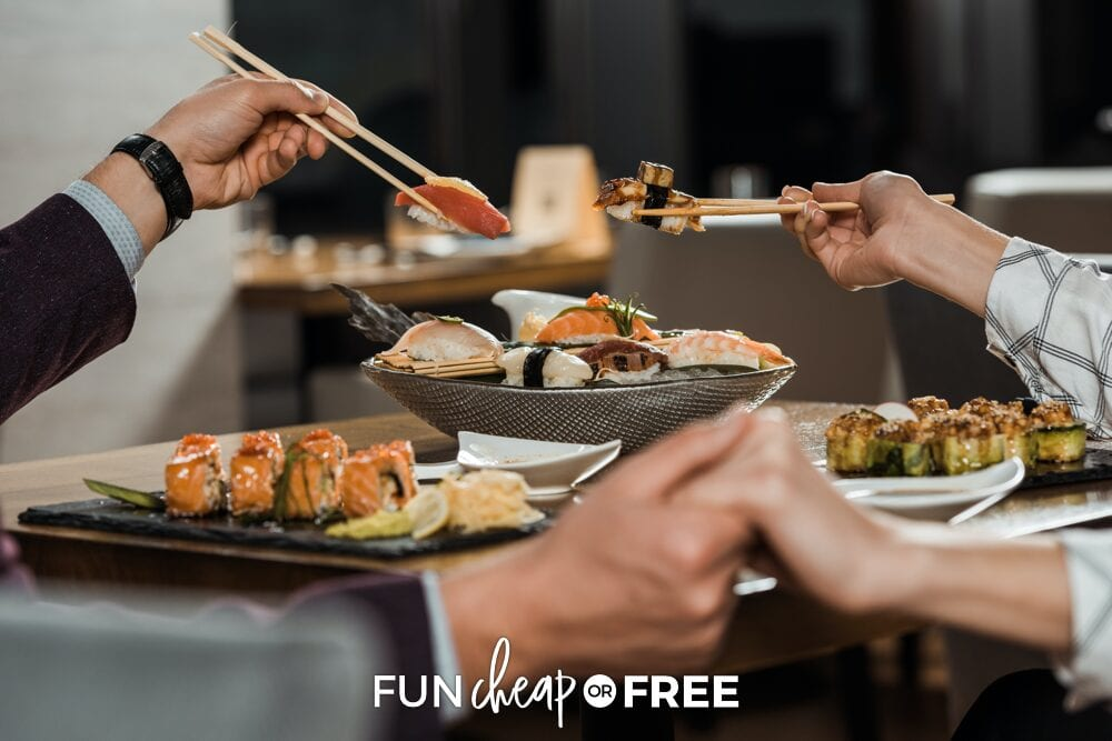 Couple holding hands while eating sushi, from Fun Cheap or Free
