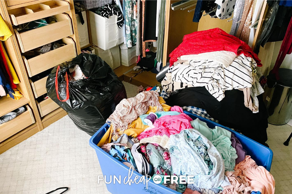 Organizing a small space closet with piles of clothes, from Fun Cheap or Free