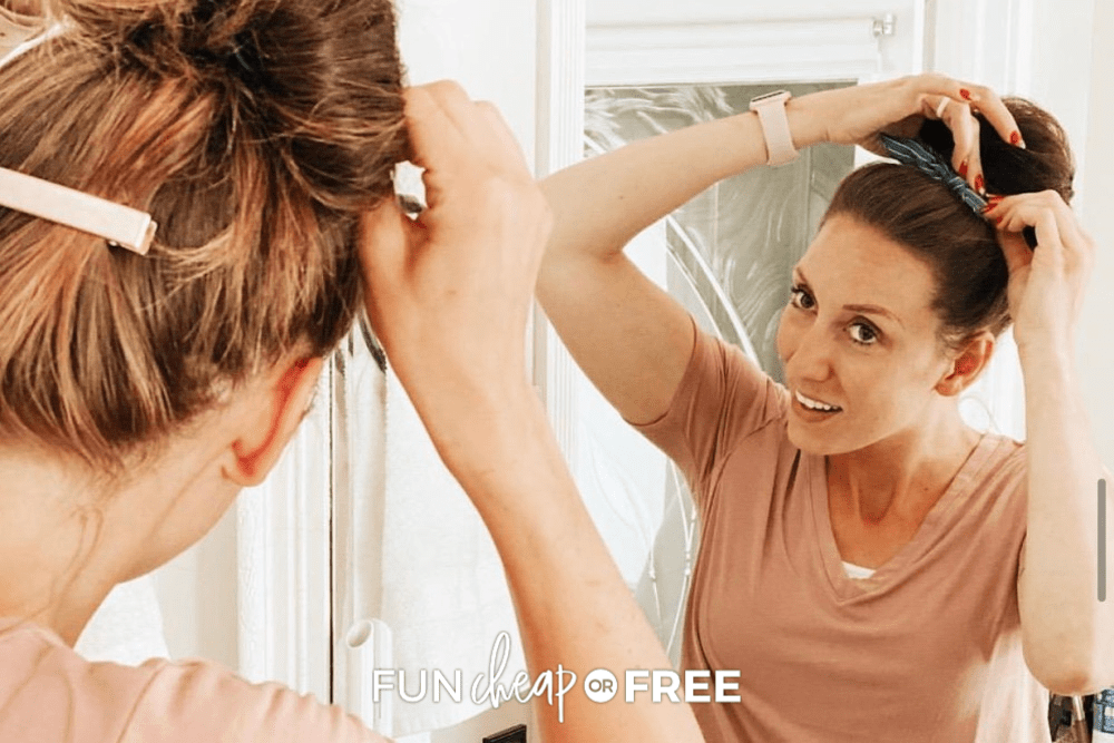 Jordan fixing her hair in the mirror representing easy hairstyles, for Fun Cheap or Free