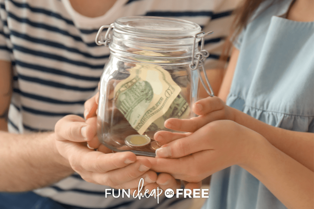 close up of mother and children holding a jar of money, from Fun Cheap or Free