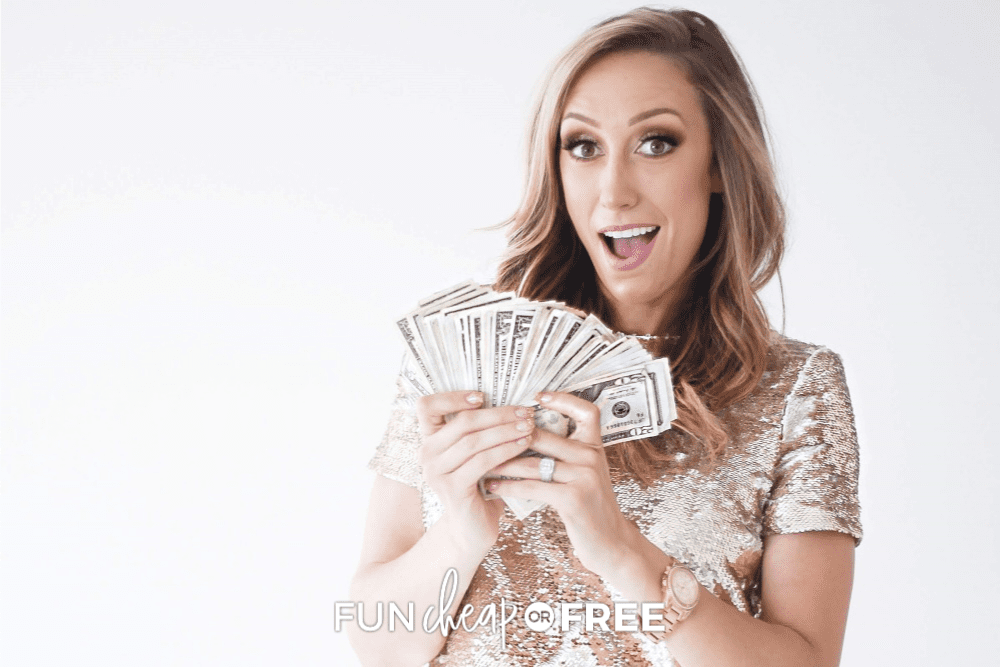 Jordan holding cash saved from finance challenge, from Fun Cheap or Free