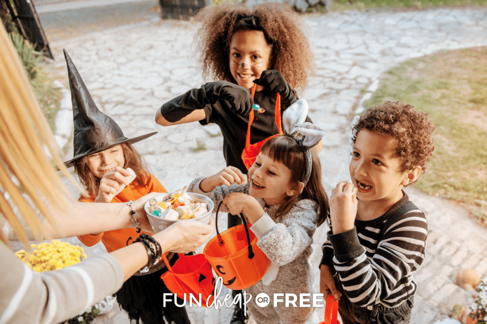 woman giving candy to trick-or-treaters, from Fun Cheap or Free