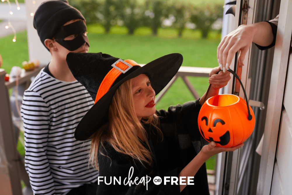 young girl dressed in witch costume trick-or-treating, from Fun Cheap or Free