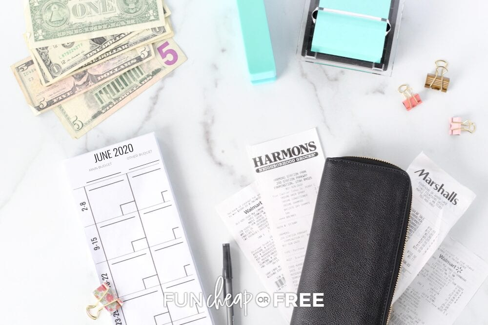 Money, budgeting envelopes, and receipts on a table, from Fun Cheap or Free
