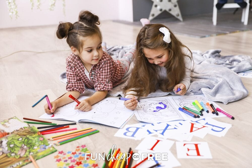 Girls coloring on coloring pages on the floor, from Fun Cheap or Free
