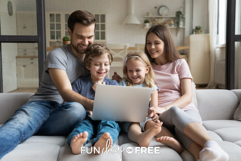 Family sitting on couch looking at a laptop with a slush fund account, from Fun Cheap or Free
