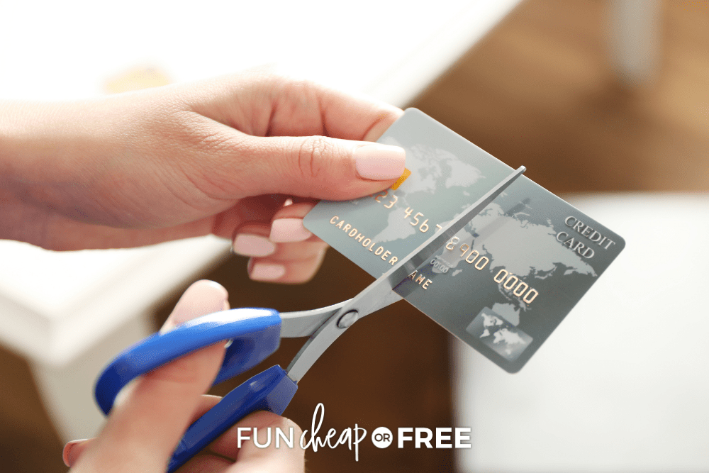 cutting up credit card with scissors held in hands, from Fun Cheap or Free