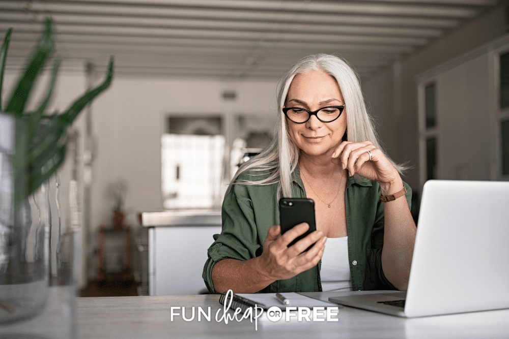female senior citizen sitting at desk using a phone, from Fun Cheap or Free
