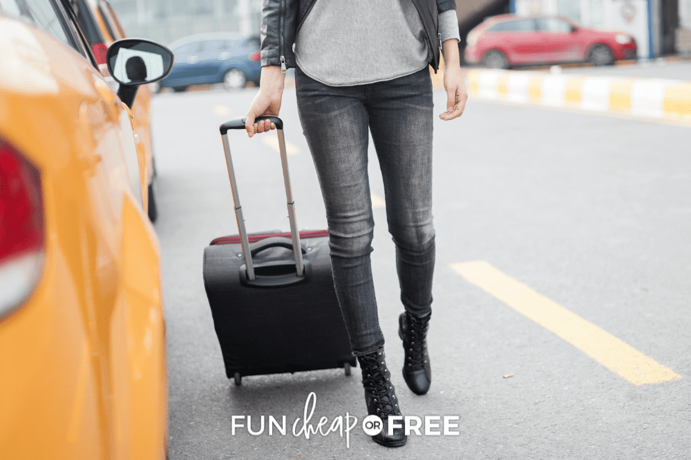 woman pulling her suitcase and getting into a taxi from Fun Cheap or Free