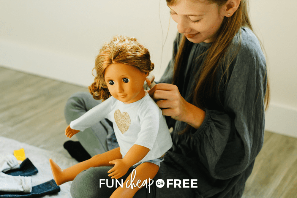 girl playing with her doll's hair, from Fun Cheap or Free