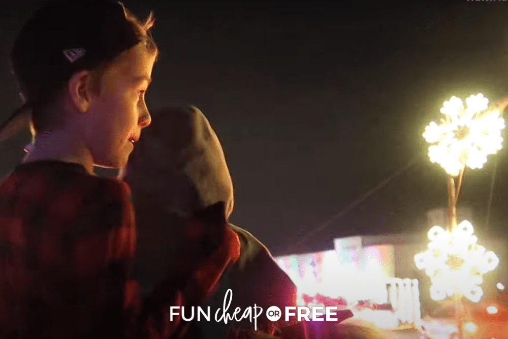 Two young boys looking at Christmas lights at night, from Fun Cheap or Free