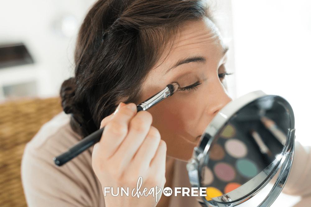 woman applying eye makeup, from Fun Cheap or Free