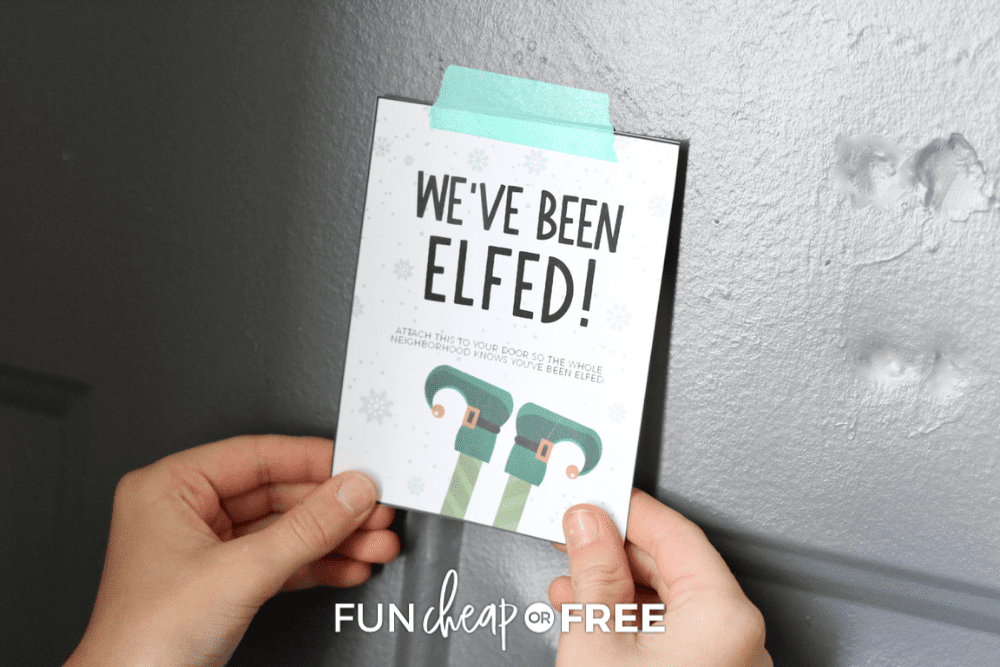 hanging a you've been elfed sign on door, from Fun Cheap or Free