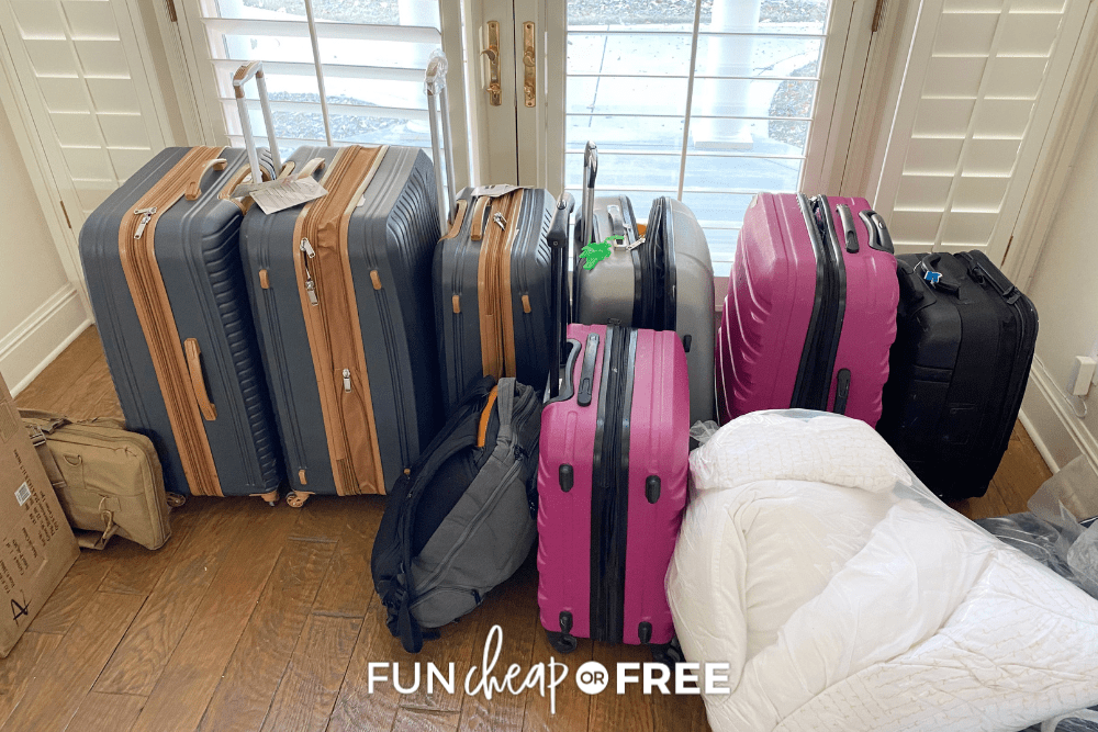 packed suitcases in front of a window, from Fun Cheap or Free