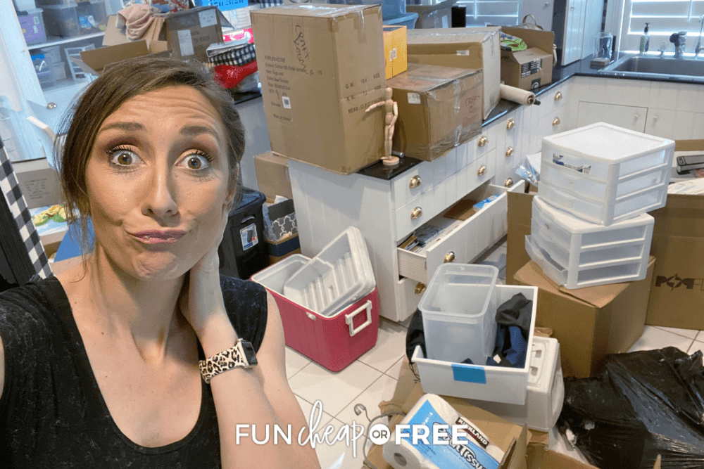 Jordan Page in front of moving boxes, from Fun Cheap or Free