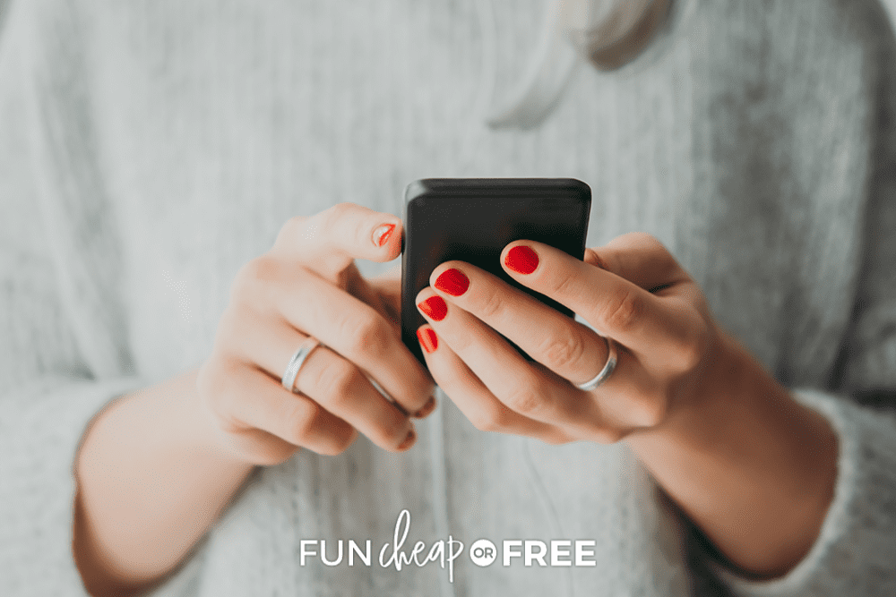 woman holding phone, using productivity app, from Fun Cheap or Free
