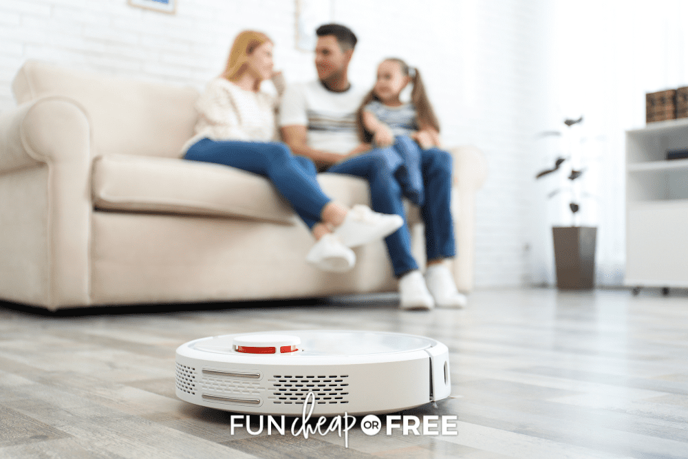 family sitting on couch with robotic vacuum on floor, from Fun Cheap or Free