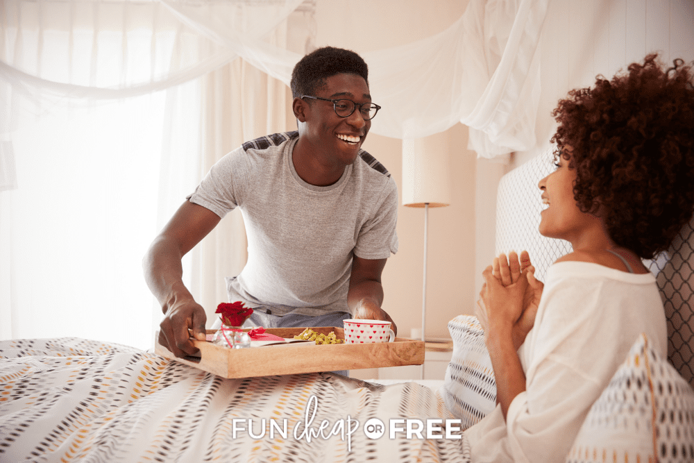 husband serving wife breakfast in bed for Valentine's Day, from Fun Cheap or Free