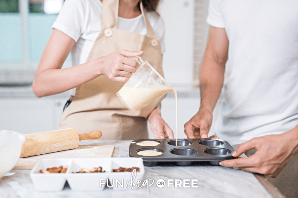 couple cooking together during an at-home date, from Fun Cheap or Free