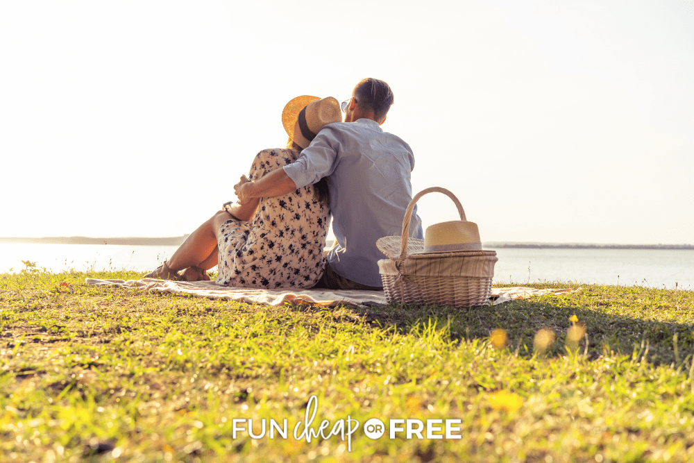 couple on a date enjoying a picnic by the water, from Fun Cheap or Free