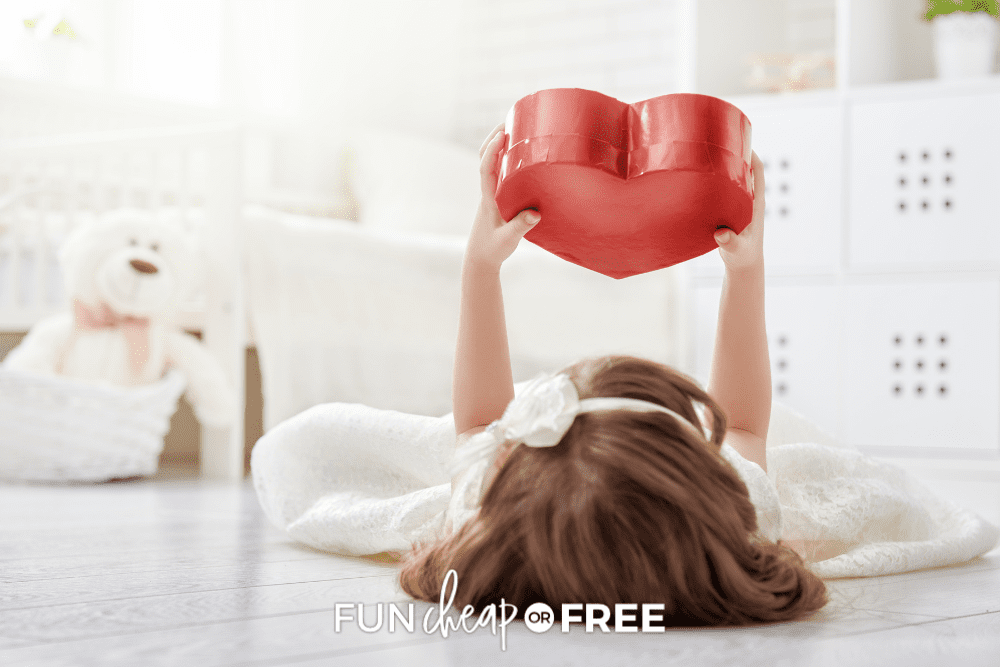 little girl holding up a heart, from Fun Cheap or Free