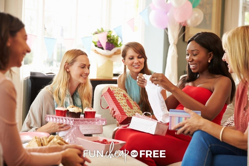 woman opening gifts at baby shower, from Fun Cheap or Free