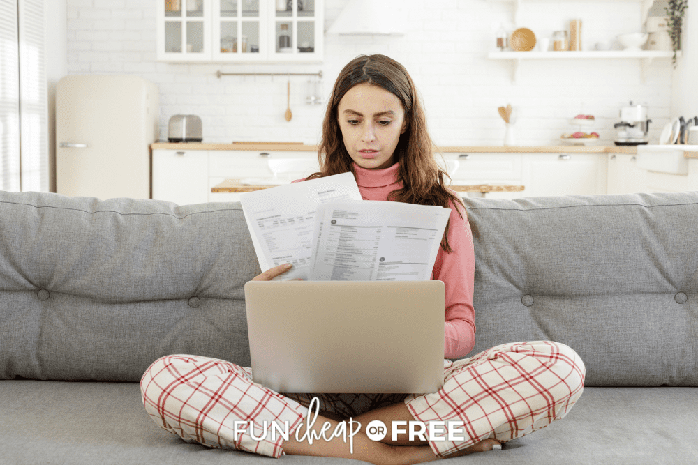 woman sitting on couch doing taxes, from Fun Cheap or Free