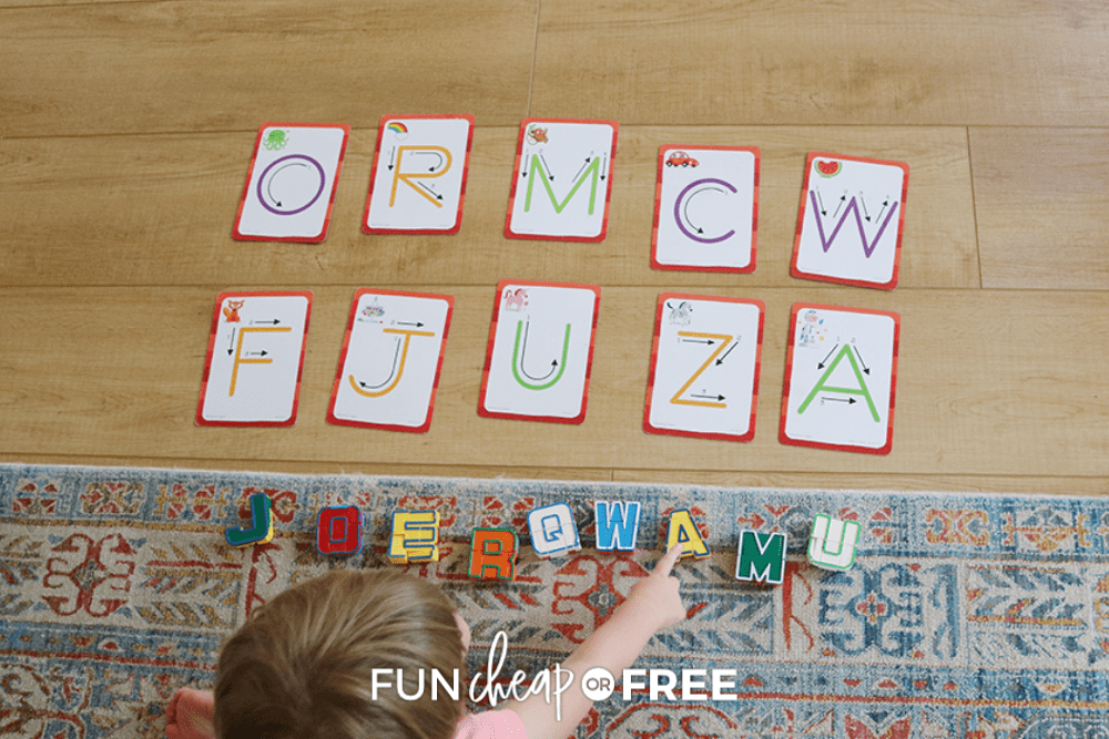 kid playing with alphabet cards, from Fun Cheap or Free