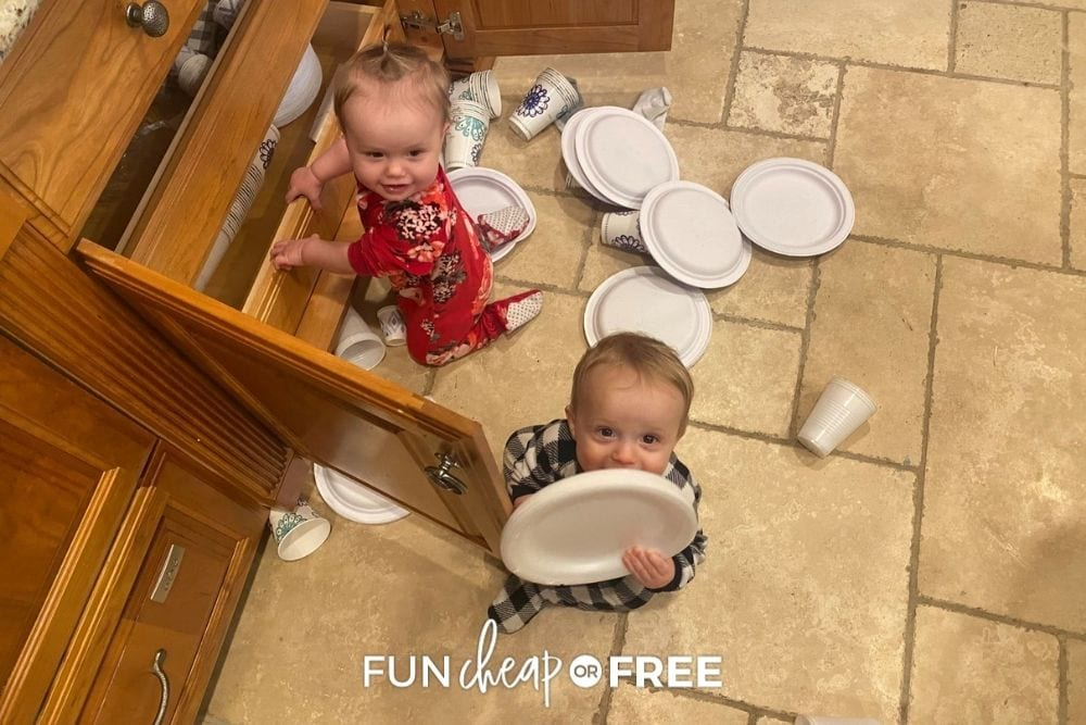 twin toddlers playing in kitchen cabinet, from Fun Cheap or Free