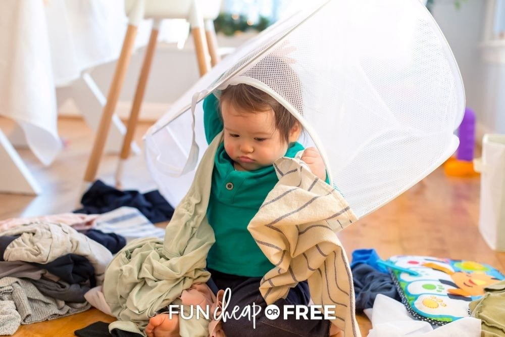toddler playing in laundry hamper, from Fun Cheap or Free