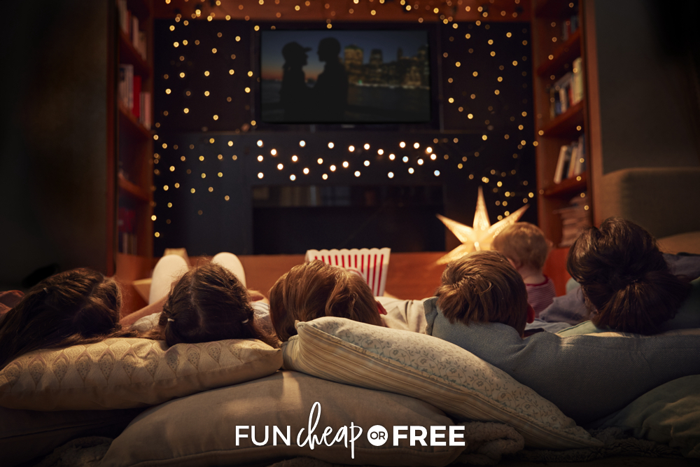 Family watching a movie together on pillows, from Fun Cheap or Free