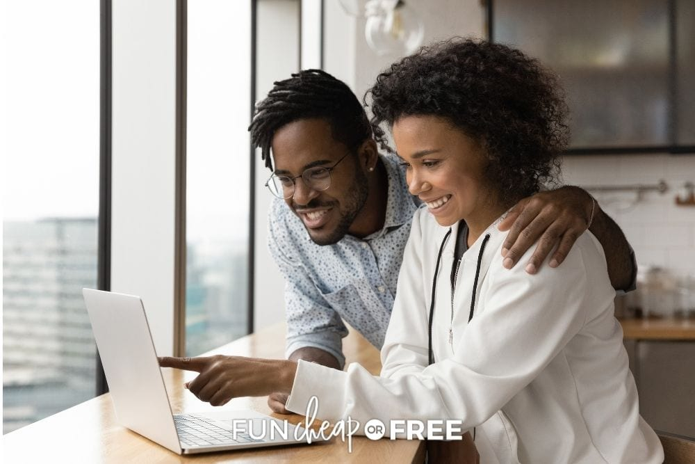 couple on laptop making wedding registry, from Fun Cheap or Free