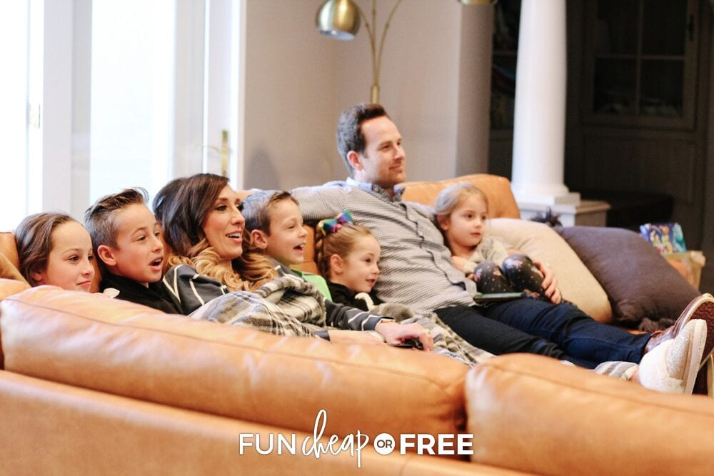 The Page family watching a movie on the couch, from Fun Cheap or Free