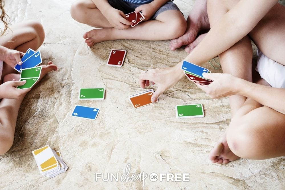 Kids and mom playing colorful cards, from Fun Cheap or Free.
