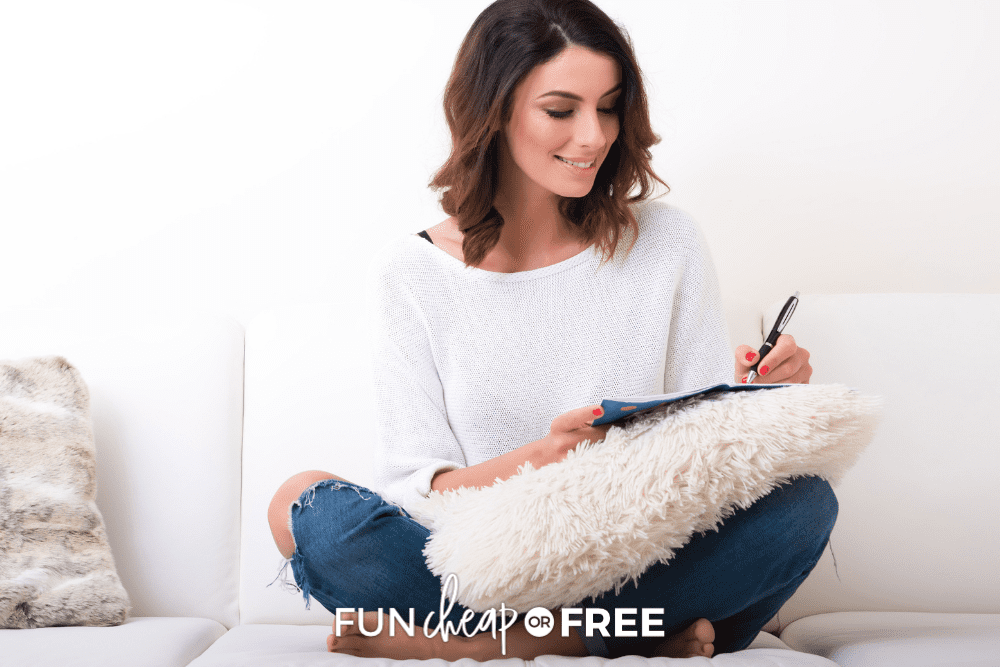 woman writing mental load in planner, from Fun Cheap or Free