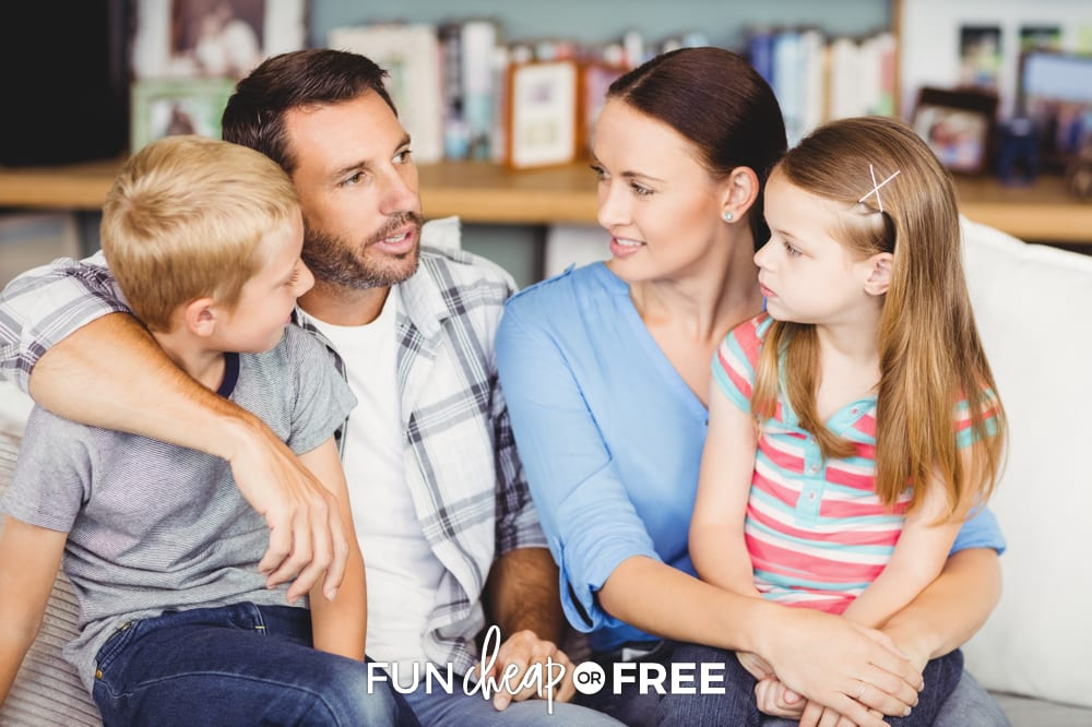 family discussing mental load on couch, from Fun Cheap or Free