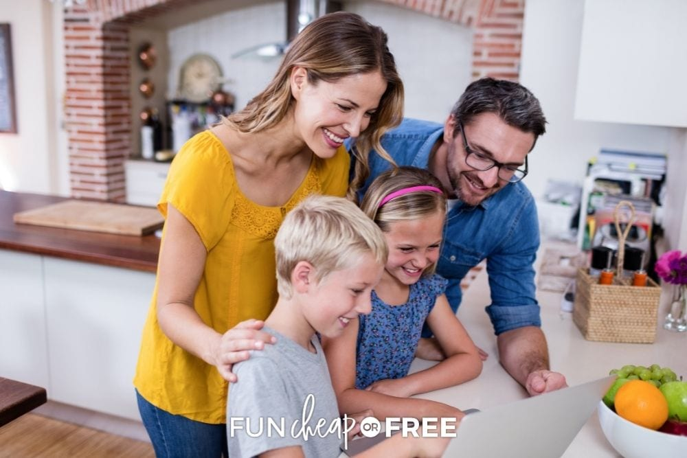 Family looking at laptop from Fun Cheap or Free.