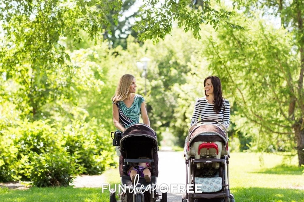 Two moms walking with strollers from Fun Cheap or Free.