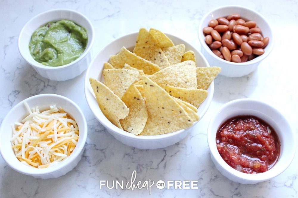 Tortilla chips and dips in bowls from Fun Cheap or Free.