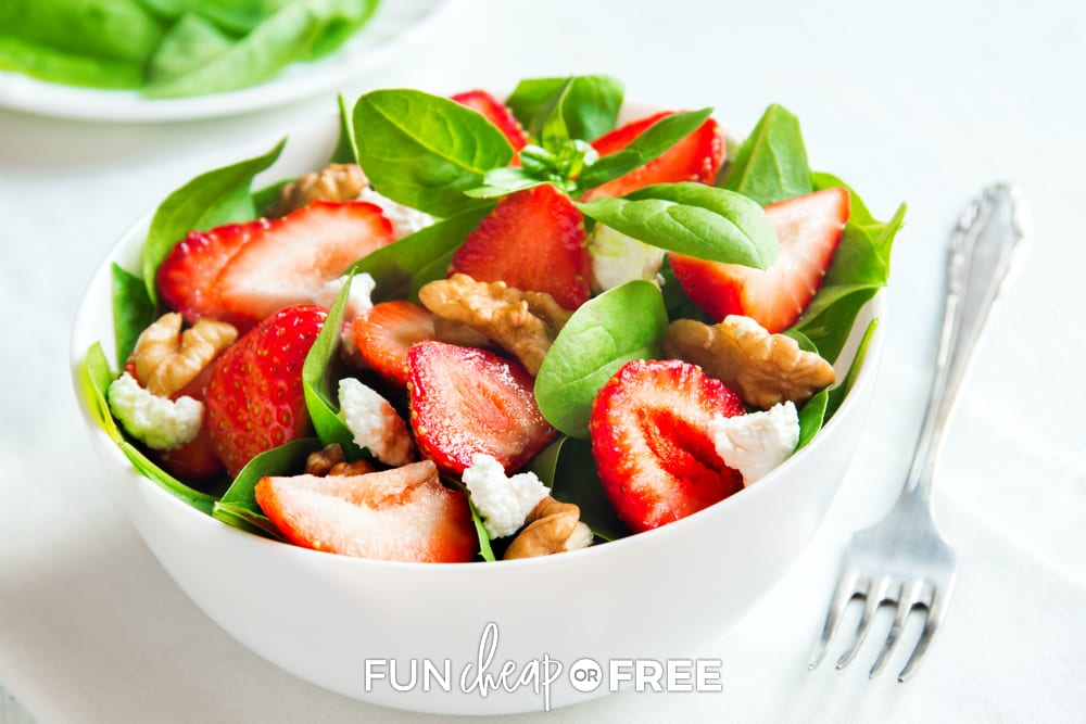 Spinach salad with strawberries in a bowl from Fun Cheap or Free.