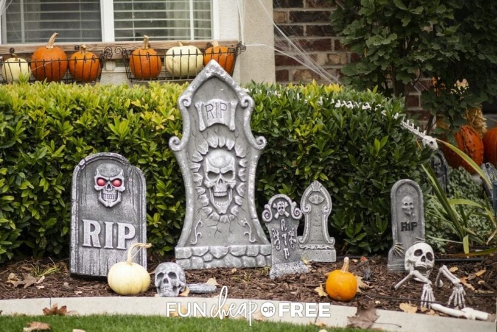 Pretend headstones in a yard for Halloween decor from Fun Cheap or Free.