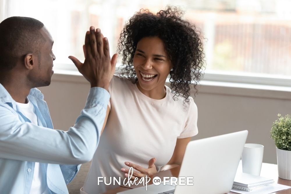 Couple high diving in front of a laptop screen from Fun Cheap or Free.