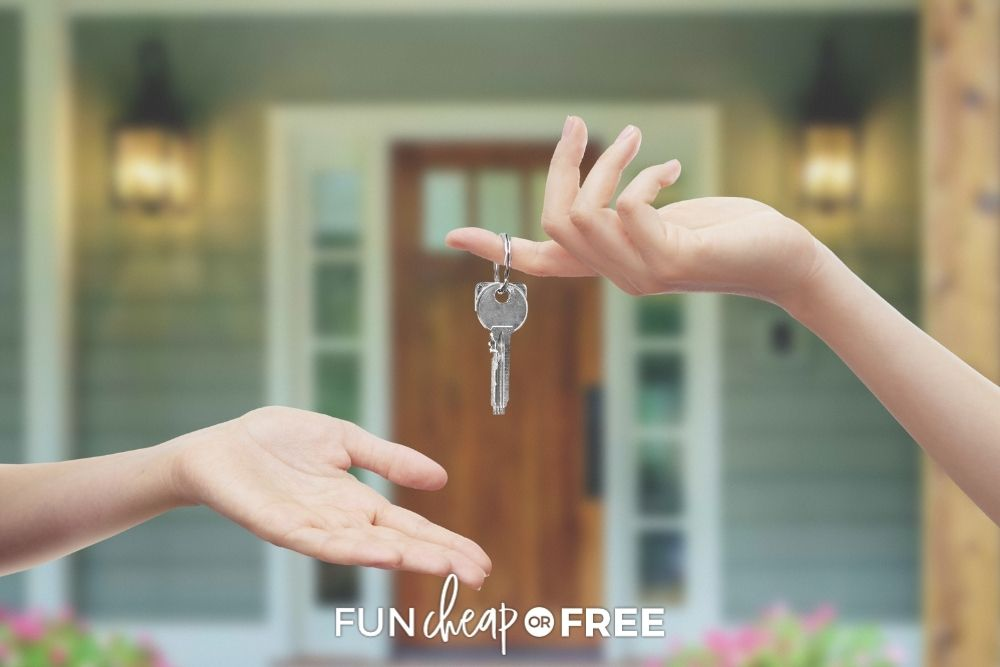 Hands handing the key to a house over from Fun Cheap or Free.