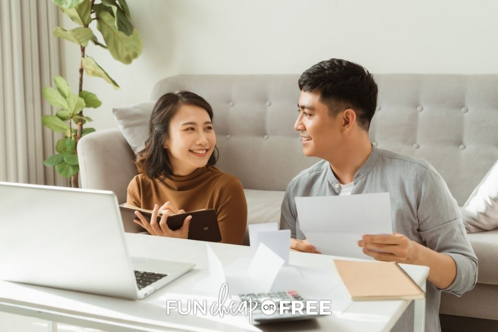 couple at home reviewing finances, from Fun Cheap or Free